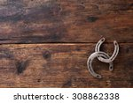 Two Old Rusty Horseshoes On...