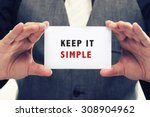 Stock photo executive holding card with message saying keep it simple 308904962