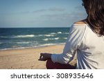 the girl in meditation on the... | Shutterstock . vector #308935646