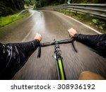 Rainy Day Man On Road Bike. Po...