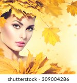 Autumn Woman With Yellow Leave...