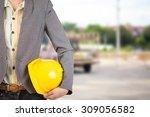 engineer holding yellow helmet... | Shutterstock . vector #309056582