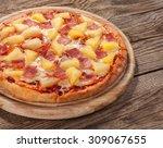 Hawaiian Pizza On The Old Board.