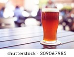 pint of crafted ale on wooden... | Shutterstock . vector #309067985