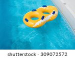 Yellow Rubber Ring Floating On...