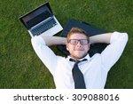 tired freelancer lying in the... | Shutterstock . vector #309088016