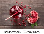 ripe pomegranates with juice on ... | Shutterstock . vector #309091826