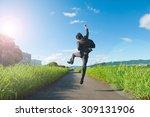business man jump with blue sky ... | Shutterstock . vector #309131906