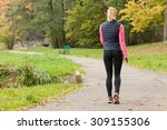 Fit Woman Walking In Park...