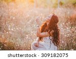 beautiful young woman with long ... | Shutterstock . vector #309182075
