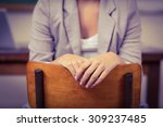 teacher sitting on chair in a... | Shutterstock . vector #309237485