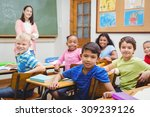 students and teacher looking at ... | Shutterstock . vector #309239126