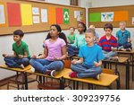 Постер, плакат: Pupils meditating on classroom