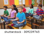 pupils meditating on classroom... | Shutterstock . vector #309239765