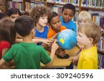 students pointing at a globe at ... | Shutterstock . vector #309240596