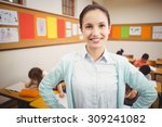 teacher smiling at camera in... | Shutterstock . vector #309241082