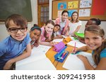 teacher and pupils working at... | Shutterstock . vector #309241958