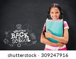 cute pupil smiling at camera in ... | Shutterstock . vector #309247916