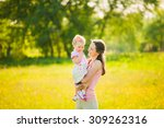 mother playing with her child... | Shutterstock . vector #309262316
