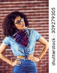 attractive hipster posing with... | Shutterstock . vector #309279305