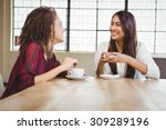 two smiling friends having... | Shutterstock . vector #309289196