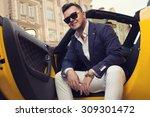 stylish man sitting in sport car | Shutterstock . vector #309301472