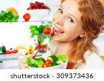 happy woman eats healthy food... | Shutterstock . vector #309373436