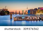 Stock photo panoramic view of berlin skyline with famous tv tower and oberbaum bridge with old ship wreck lying 309376562