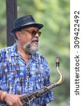 "Small photo of NEW YORK CITY - AUGUST 23 2015: Thousands filled Tompkins Square Park to hear live jazz performances celebrating the life of Charlie ""Yardbird"" Parker. Alto saxophonist Joe Lovano on state"
