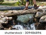 Feet Of Female Hiker On Bridge...