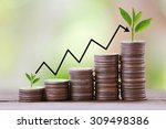 silver coin stack and arrow... | Shutterstock . vector #309498386