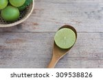 slice of fresh limes on old... | Shutterstock . vector #309538826