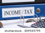 income and tax   blue binder on ... | Shutterstock . vector #309545795
