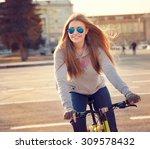 beautiful young woman with bike ... | Shutterstock . vector #309578432