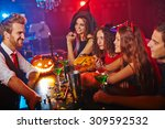 disguised people drinking in... | Shutterstock . vector #309592532