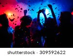 silhouettes of dancers moving... | Shutterstock . vector #309592622