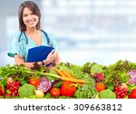 doctor woman with vegetables.... | Shutterstock . vector #309663812