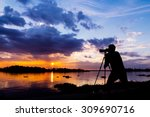 Silhouette Of Photographer...