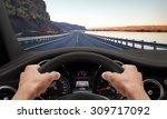 Hands steering wheel. Highway car driving. - stock photo
