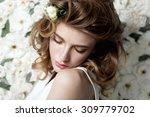 portrait of a beautiful girl on ... | Shutterstock . vector #309779702