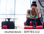 tired sports woman sitting on... | Shutterstock . vector #309781112