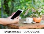 close up of hands woman using... | Shutterstock . vector #309799646