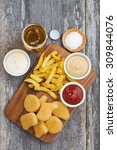 chicken nuggets with french... | Shutterstock . vector #309844076