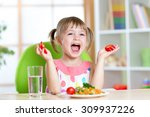 kid girl eating healthy... | Shutterstock . vector #309937226