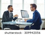 confident businessmen sitting... | Shutterstock . vector #309942056