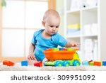 Child Toddler Playing Wooden...