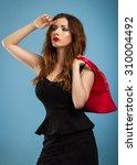 pensive beautiful girl in black ... | Shutterstock . vector #310004492