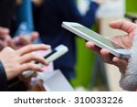 using a phone at a city  | Shutterstock . vector #310033226