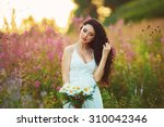 beautiful young woman in purple ... | Shutterstock . vector #310042346