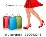 shopping woman wearing red... | Shutterstock .eps vector #310043348